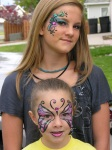 butterfly face paint and elegant eye makeup